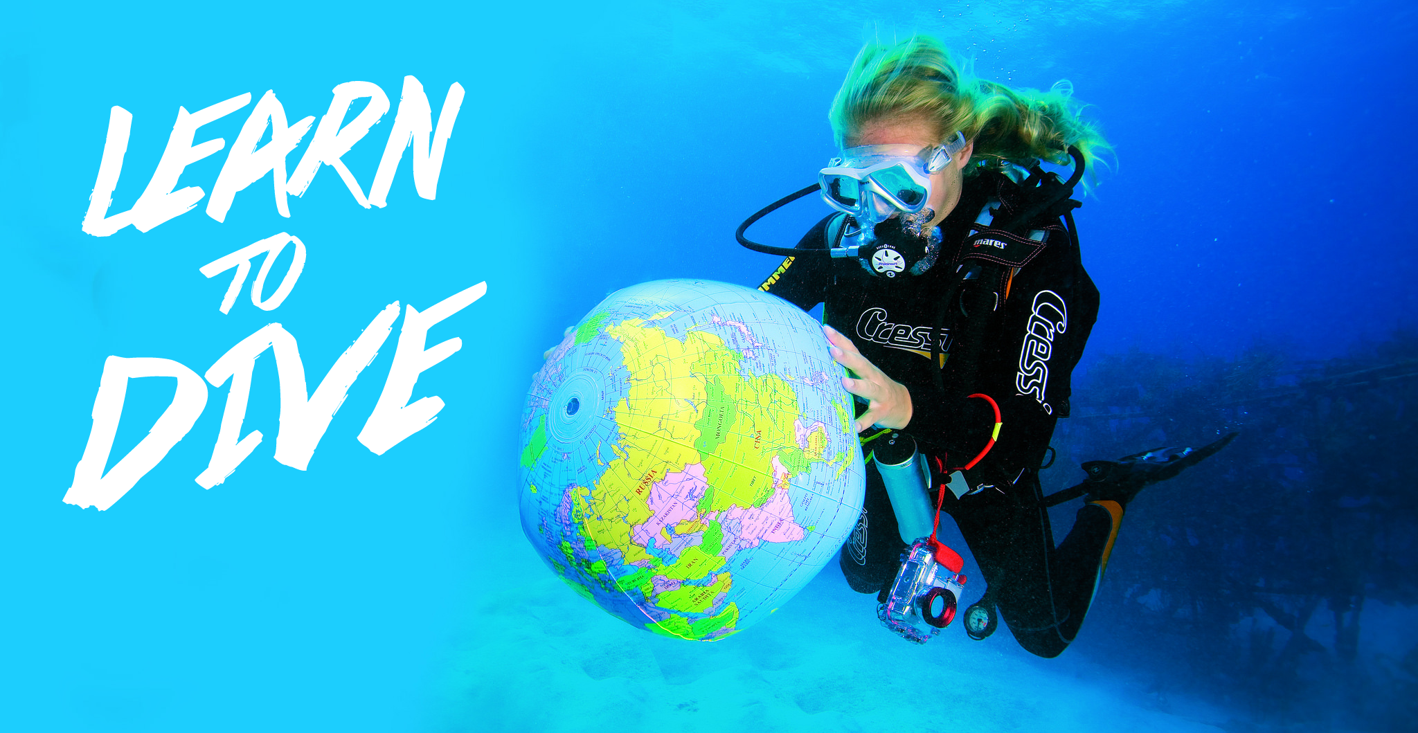 PADI Open water diver in tropical water with New Horizons Cheshire